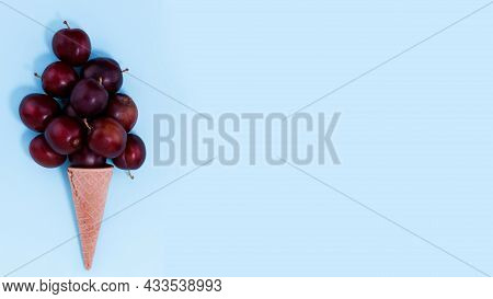 Ice Cream Cone With Plums. Fresh Fruits In Cone. Сopy Space