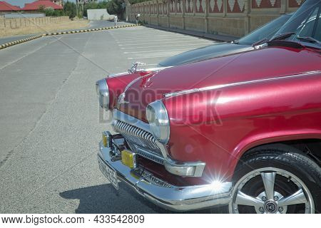 Close-up View Of The Old Russian Car Gaz-21 Volga Parked In The Yard. Soviet Retro Car From 1950S An