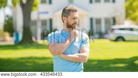 Serious Mature Man Realtor Standing Outdoor At House, Broker