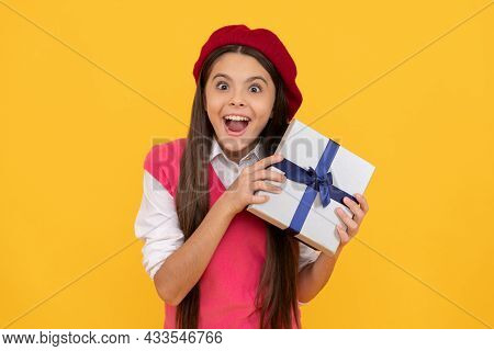 Surprised Teen Girl In French Beret Hold Present Or Gift Box On Yellow Background, Birthday