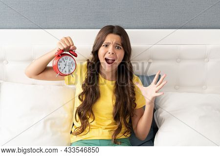Her Alarm Clock Hadnt Gone Off. Girl Overslept Screaming In Panic. Shouting Child Hold Alarm Clock