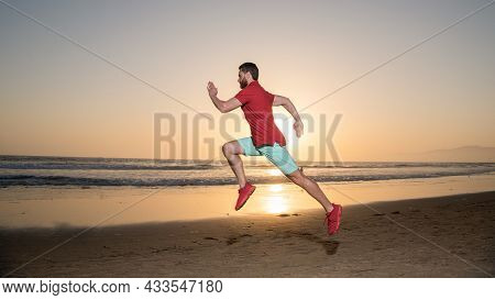 Hurry Up. Endurance And Stamina. Sprinter. Sport Athlete Run Fast To Win In Sea Sunset.