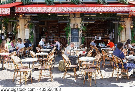 Paris, France-september 18, 2021 : The Traditional French Cafe La Maison Rouge Located In The Famous