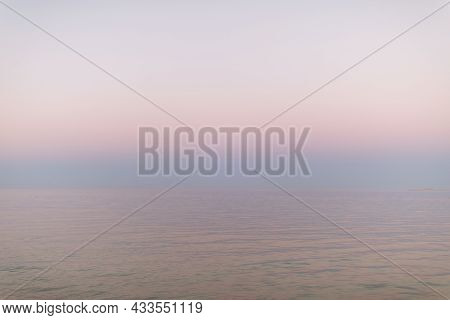 Peaceful Sunset At The Ocean. Pastel Pink Gradient From Water To Sky. Abstract Minimalist Background