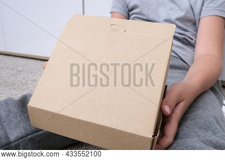 A Boy Unboxing Unpacking A Parcell, Delivery, Online Shopping Purchase Concept