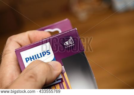 Paris, France - Aug 2, 2021: Pov Personal Perspective At Male Hand Holding New Package Of Philips Le