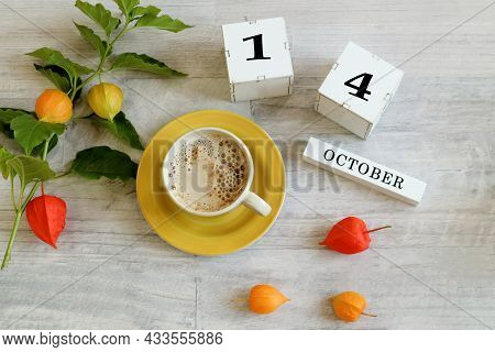 Calendar For October 14 : The Name Of The Month In English, Cubes With The Number 14, A Yellow Cup W