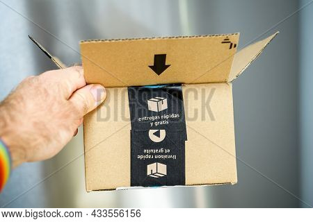 Paris, France - Sep 8, 2021: Pov Personal Perspective Male Hand Holding Amazon Prime Cardboard Packa