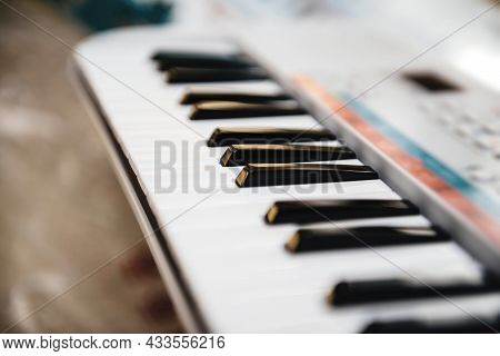 Paris, France - Sep 8, 2021: Side View Of Yamaha Remie Digital Keyboard Pss-e30 For Kids With Multip