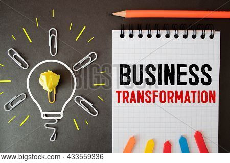 Text Business Transformation On White Paper. Concept