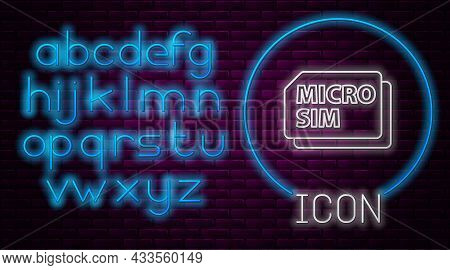 Glowing Neon Line Micro Sim Card Icon Isolated On Brick Wall Background. Mobile And Wireless Communi