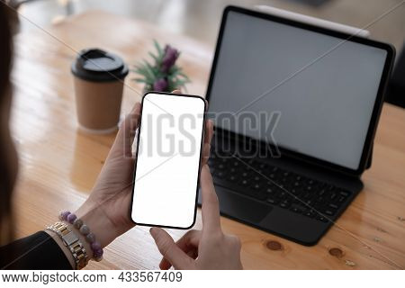 A Woman Hand Holding Smartphone Device With Blank Screen. Blank Screen For Your Advertising.