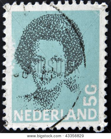 A stamp printed in the Netherlands shows Beatrix of the Netherlands