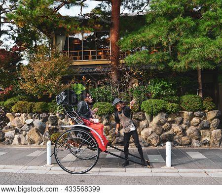 Traveler Enjoying Kyoto Rickshaw Tour