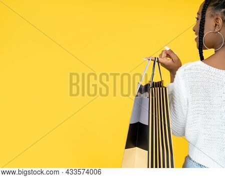 Store Sale. Special Offer. Holiday Shopping. Back View Of Happy African Woman Holding Shopper Bags I