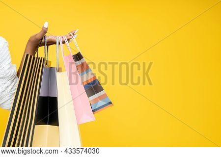 Shopping Sale. Shopaholic Lifestyle. Black Friday. Closeup Of African Woman Hand Holding Paper Bags