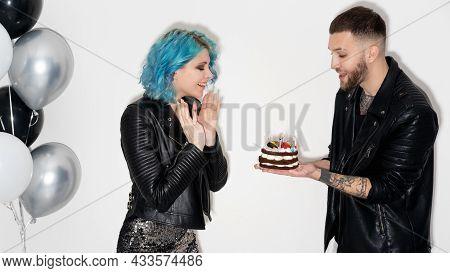 Birthday Surprise. Happy Couple. Festive Celebration. Party Joy. Cheerful Man Presenting Holiday Cak