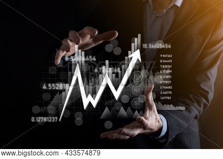 Hand Hold Sales Data And Economic Growth Graph Chart. Business Planning And Strategy. Analysing Trad