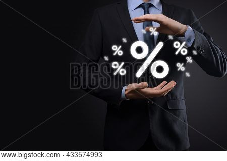 Male Hand Holding Interest Rate Percent Icon On Blue Background. Interest Rate Financial And Mortgag