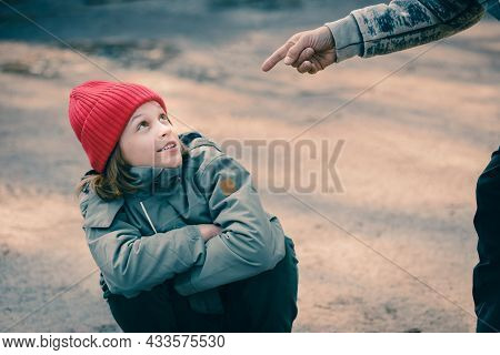 Young Teenager Boy Talking With Male Criminal Threatening Him