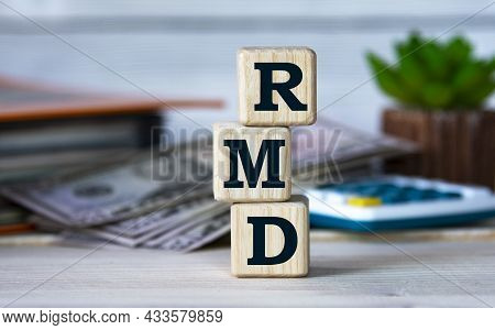 Rmd (required Minimum Distribution) - Abbreviation For Wooden Cubes On The Background Of A Folder, C