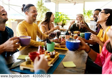 Smiling Group Of Diverse Friends Having Breakfast And Talking At Coffee Bar Restaurant - Happy Mille