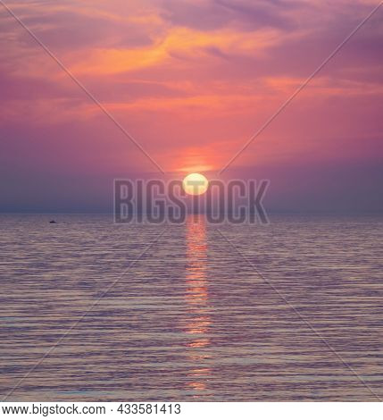 Big sun and sea sunset background. Nature composition.