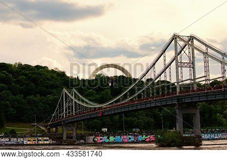 Kyiv, Ukraine-may 04, 2021:scenic Landscape View Of Pedestrian Bridge Over Dnipro River In Cloudy Da