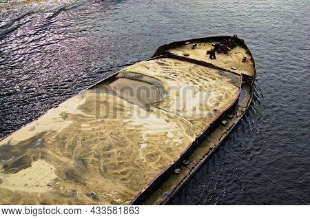 Close-up View Of Cargo Ship Barge Loaded With Sand. Top View Of The Front Of The Barge.