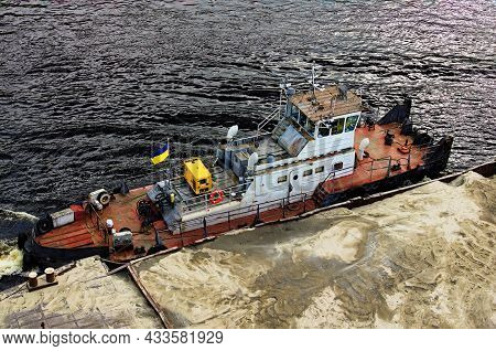 River Barge Loaded With Sand. Close-up View Of Cargo Ship Barge Loaded With Sand. Top View Of The Fr