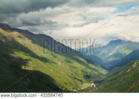 Landscape Valley Mountain Gorge With Clouds And Beautiful Sunlight. Baksan Gorge Kabardino-balkaria