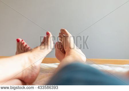 Feet Of Couple On The Bed. Man And Woman Resting Love On Bed.sex On Vacation Theme. Valentine And Ho