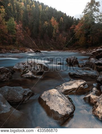 Beautiful View Of The River Flow Between The Rocks