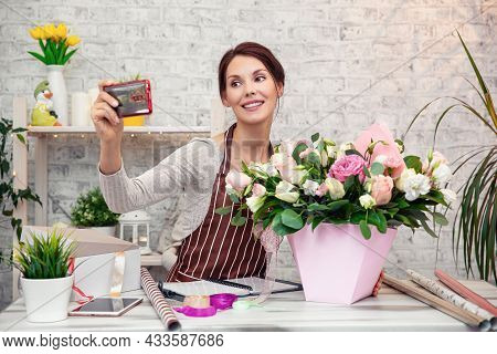 Young Woman Florist At Work. Business Woman Takes A Selfie With A Bouquet, Happy Smiling Woman Makin
