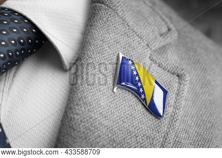 Metal Badge With The Flag Of Bosnia And Herzegovina On A Suit Lapel