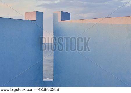 Picturesque Geometric Building Design. Blue Facade. Calpe, Spain