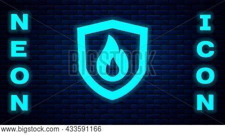 Glowing Neon Fire Protection Shield Icon Isolated On Brick Wall Background. Insurance Concept. Secur