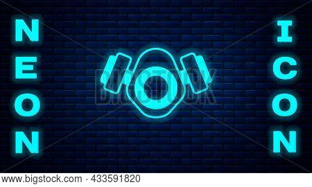 Glowing Neon Gas Mask Icon Isolated On Brick Wall Background. Respirator Sign. Vector