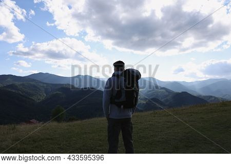 Tourist With Backpack Enjoying Majestic Mountain Landscape, Back View