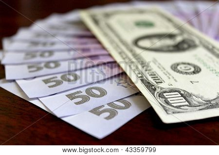 grivna banknotes with value of 50 and hundred of dollars