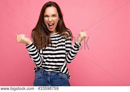 Portrait Of Young Positive Happy Attractive Brunette Woman With Sincere Emotions Wearing Casual Stri