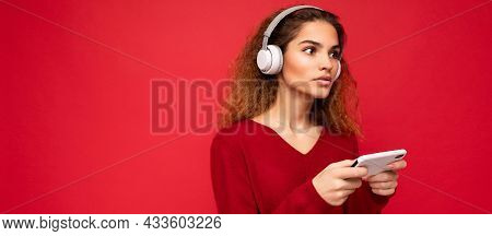 Panoramic Photo Shot Of Beautiful Concentrated Young Female Person Wearing Stylish Casual Outfit Iso