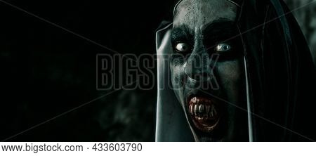 closeup of a scary evil nun, showing her and frightening bloody teeth, in a typical black and white habit, in a panoramic format to use as web banner or header