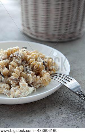 Delicious Dish Fusilli Pasta With Creamy Mushroom Sauce On A Gray Stone Table