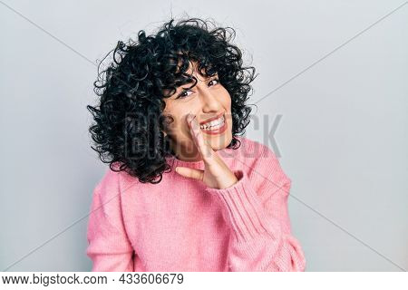 Young middle east woman wearing casual clothes hand on mouth telling secret rumor, whispering malicious talk conversation