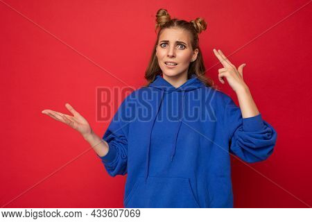Portrait Of Dissatisfied Tired Young Beautiful Winsome Blonde Woman With Two Horns With Sincere Emot