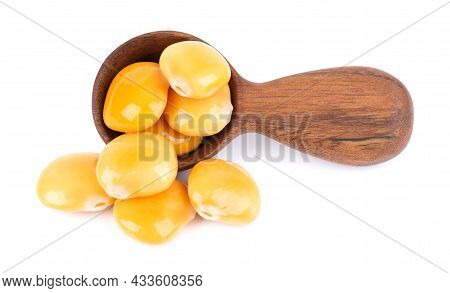 Pickled Yellow Lupine Beans In Wooden Spoon, Isolated On White Background. Tournus, Preserved Lupinu