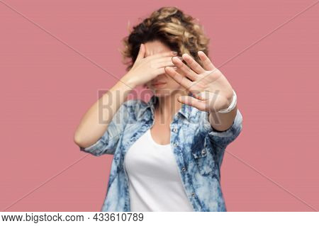 Stop, I Dont Want To Look At This. Portrait Of Confused Or Scared Young Woman With Curly Hair Standi