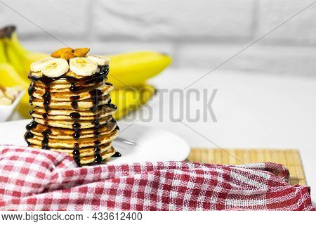 Pancakes With Chocolate Syrup, Nuts And Bananas. Stack Of Whole Flapjack. Tasty Breakfast And Health