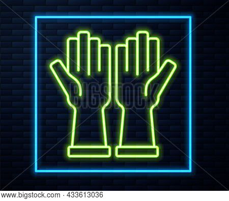 Glowing Neon Line Rubber Gloves Icon Isolated On Brick Wall Background. Latex Hand Protection Sign.